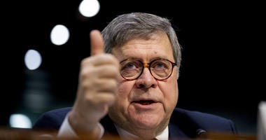 FILE - In this Jan. 15, 2019, file photo, then-Attorney General nominee William Barr testifies during a Senate Judiciary Committee hearing on Capitol Hill in Washington.