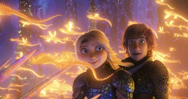 """This image released by Universal Pictures shows characters Astrid, voiced by America Ferrera, left, and Hiccup, voiced by Jay Baruchel, in a scene from DreamWorks Animation's """"How to Train Your Dragon: The Hidden World."""""""