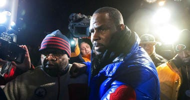 R. Kelly surrenders to authorities at Chicago First District police station, Friday, Feb. 22, 2019.