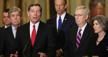 Sen. John Barrasso, R-Wyo., with, from left, Sens. Todd Young, R-In., Roy Blunt, R-Mo., Barasso, John Thune, R-S.D., Senate Majority Leader Mitch McConnell, R-Ky., and Joni Ernst, R-Iowa, speaks to reporters on Capitol Hill in Washington, Tuesday, Feb. 26