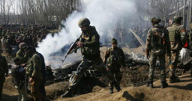 Indian army soldiers arrive at the wreckage of an an Indian helicopter after it crashed in Budgam area, outskirts of Srinagar, Indian controlled Kashmir, Wednesday, Feb.27, 2019.