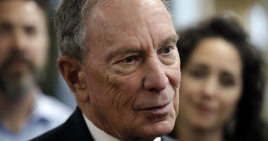 FILE - In this Jan. 29, 2019 file photo, Michael Bloomberg speaks to workers during a tour of the WH Bagshaw Company, a pin and precision component manufacturer, in Nashua, N.H.