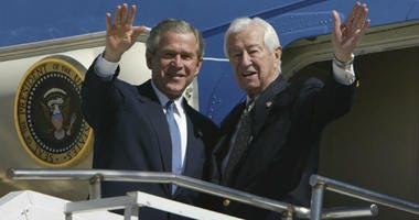 FILE - In this March 8, 2004, file photo, then President Bush, left, waves with Rep. Ralph Hall, R-Texas, right, as they step off Air Force One upon Bush's arrival in Dallas.