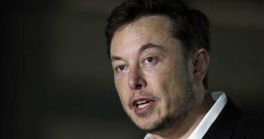 FILE - In this June 14, 2018, file photo, Tesla CEO Elon Musk speaks at a news conference in Chicago.