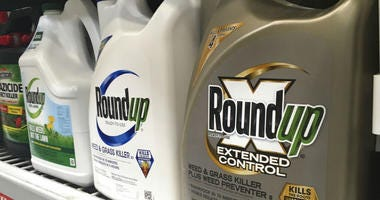 Containers of Roundup are displayed on a store shelf in San Francisco.