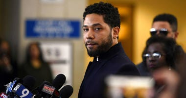 Actor Jussie Smollett talks to the media before leaving Cook County Court after his charges were dropped.