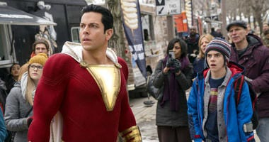 "This image released by Warner Bros. shows Zachary Levi, left, and Jack Dylan Grazer in a scene from ""Shazam!"""