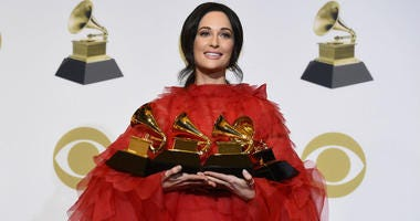 ""\Kacey Musgraves, winner of the awards for best country album for """"Golden Hour"""", best country song for """"Space Cowboy"""", best country solo performance for """"Butterflies"""" and album of the year for """"Golden Hour"""" poses in""380|200|?|en|2|4341c8e9445d7d10a0c1b7f860220718|False|UNSURE|0.35632267594337463