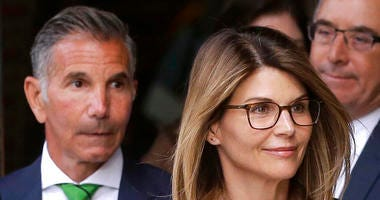 Lori Loughlin (front) and Mossimo Giannulli (left)