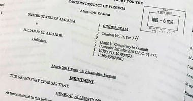 The Grand Jury Indictment against Julian Assange, released by the U.S. Department of Justice, Thursday, April 11, 2019, is photographed in Washington.