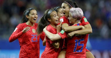 United States' Alex Morgan, second right, celebrates after scoring her side's 12th goal during the Women's World Cup Group F soccer match between United States and Thailand at the Stade Auguste-Delaune in Reims, France, Tuesday, June 11, 2019.