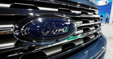 In this file photo dated Thursday, March 28, 2019, the Ford Motor company logo at the auto show in Denver.