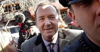FILE - In this Jan. 7, 2019 file photo, actor Kevin Spacey arrives at district court in Nantucket, Mass. A young man who says Kevin Spacey groped him in a Nantucket bar in 2016 has dropped his lawsuit against the Oscar-winning actor.