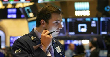 Dow Jones industrials cross 27,000 points for first time