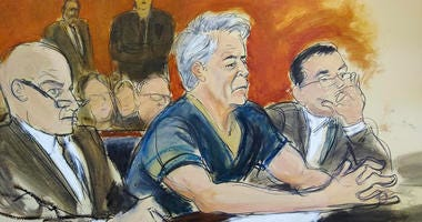 In this courtroom artist's sketch, defendant Jeffrey Epstein, center, sits with attorneys Martin Weinberg, left, and Marc Fernich during his arraignment in New York federal court, Monday, July 8, 2019.