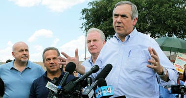 In this June 17, 2018, file photo, U.S. Sen. Jeff Merkley, from right, from Oregon, speaks to the media