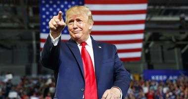 President Donald Trump gestures to the crowd as he arrives to speak at a campaign rally at Williams Arena in Greenville, N.C., Wednesday, July 17, 2019.