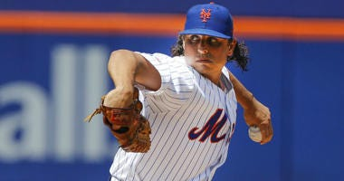 New York Mets' Jason Vargas delivers a pitch during the first inning of a baseball game against the Pittsburgh Pirates, Sunday, July 28, 2019, in New York.