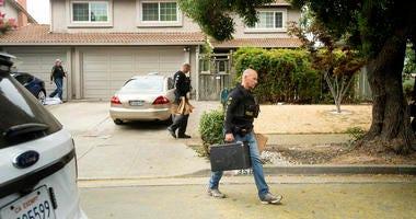 Police search home of Santino William Legan.
