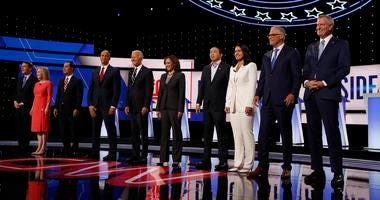 From left: Michael Bennet, Kirsten Gillibrand, Julian Castro, Cory Booker, Joe Biden, Kamala Harris, Andrew Yang, Tulsi Gabbard, Jay Inslee and Bill de Blasio are shown before the second of two Democratic debates Wednesday, July 31, 2019, in Detroit.