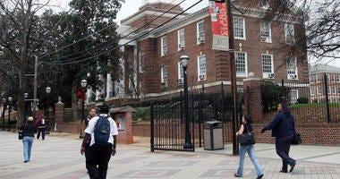 In this Feb. 12, 2009 file photo, people make their way on the Clark Atlanta University campus in Atlanta Ga.