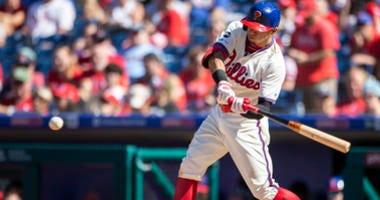 Philadelphia Phillies's Cesar Hernandez swings on a single during the sixth inning of a baseball game against the Boston Red Sox, Sunday, Sept. 15, 2019, in Philadelphia.