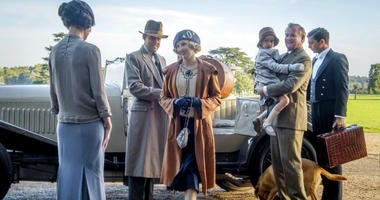 "This image released by Focus Features shows Elizabeth McGovern, from left, Harry Hadden-Paton, Laura Carmichael, Hugh Bonneville and Michael Fox, right, in a scene from the film ""Downton Abbey."""