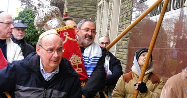 Richard Gottfried carrying a Torah outside the Tree Of Life building in Pittsburgh.
