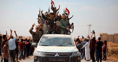 People welcome Syrian troops