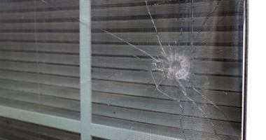 A bullet hole from the police officer's shot is seen in the rear window of Atatiana Jefferson's home in Fort Worth, Texas, Tuesday, Oct. 15, 2019.