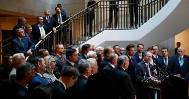 House Republicans gather for a news conference after Deputy Assistant Secretary of Defense Laura Cooper arrived for a closed door meeting to testify as part of the House impeachment inquiry into President Donald Trump, Wednesday, Oct. 23, 2019.