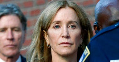 Actress Felicity Huffman leaves federal court in Boston with her brother Moore Huffman Jr., left, after she was sentenced in a nationwide college admissions bribery scandal.