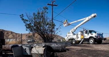 SoCal Edison workers replace power lines that were damaged from the Tick Fire, Thursday, Oct. 25, 2019, in Santa Clarita, Calif.