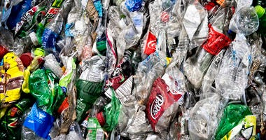 Crushed plastic bottles sit in a bale following sorting at the Mid-America Recycling plant, in Lincoln, Neb.