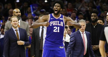 Philadelphia 76ers' Joel Embiid reacts after it was announced that he and Minnesota Timberwolves' Karl-Anthony Towns were ejected.