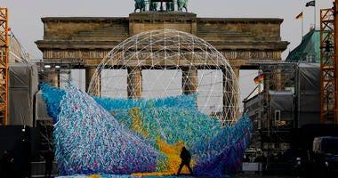 The skynet artwork 'Visions In Motion' is set to overhang the 'Strasse des 17. Juni' (Street of June 17) boulevard in front of the Brandenburg Gate in Berlin, Germany, Friday, Nov. 1, 2019.