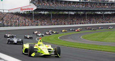 Simon Pagenaud, of France, leads the field through the first turn on the start of the Indianapolis 500 IndyCar auto race at Indianapolis Motor Speedway, in Indianapolis.