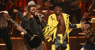 """Billy Ray Cyrus, left, and Lil Nas X perform """"Old Town Road"""" at the BET Awards in Los Angeles."""