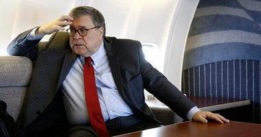 Attorney General William Barr speaks with an Associated Press reporter onboard an aircraft en route to Cleveland, Thursday, Nov. 21, 2019, during a two-day trip to Ohio and Montana.