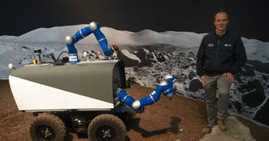 Kjetil Wormnes, automation and robotics system engineer, poses with the Space Rover after a training exercise of the European Space Agency.
