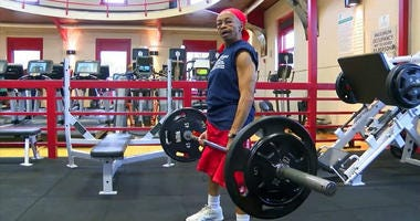 This photo shows Willie Murphy, 82, as she lifts weights at a gym in Rochester, N.Y.