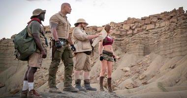 "Kevin Hart, from left, Dwayne Johnson, Jack Black and Karen Gillan in a scene from ""Jumanji: The Next Level."""