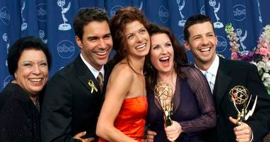 "Shelley Morrison, from left, Eric McCormack, Debra Messing, Megan Mullally and Sean Hayes celebrate their awards for their work in ""Will & Grace"" at the 52nd annual Primetime Emmy Awards in Los Angeles on Sept. 10, 2000."