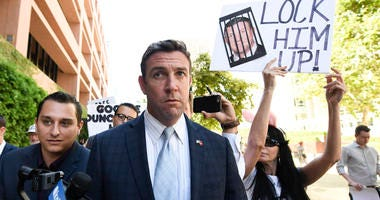 U.S. Rep. Duncan Hunter leaves federal court after a motions hearing in San Diego on July 1, 2019.
