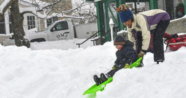 Edisa Weeks gives her 5-year-old nephew, Niko Brown, a push down a hill at the Brattleboro Little League Field, in Brattleboro, Vt..