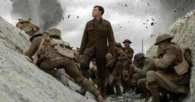 "his image released by Universal Pictures shows George MacKay, center, in a scene from ""1917,"" directed by Sam Mendes."