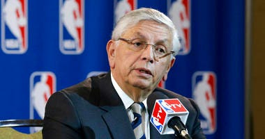 NBA Commissioner David Stern takes a question from a reporter during a news conference following an NBA Board of Governors meeting in Dallas.