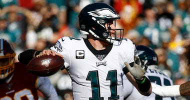 Philadelphia Eagles quarterback Carson Wentz (11) passes the ball against the Washington Redskins in the first half of an NFL football game, Sunday, Dec. 15, 2019, in Landover, Md.