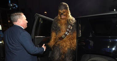 """A Chewbacca character exits a car as he arrives at the world premiere of """"Star Wars: The Rise of Skywalker"""" on Monday, Dec. 16, 2019, in Los Angeles."""
