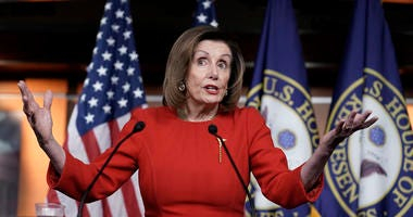 Speaker of the House Nancy Pelosi, D-Calif., meets with reporters on Wednesday, the morning after the House of Representatives voted to impeach President Donald Trump on charges of abuse of power and obstruction of Congress.